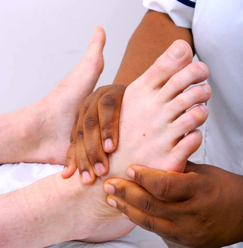 Podiatrist working on a foot